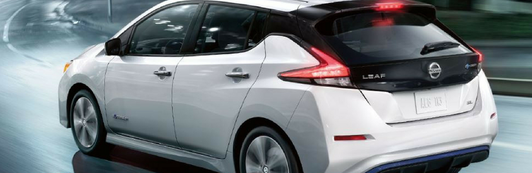 2019 Nissan Leaf driving down road.