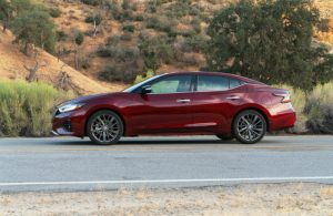 left side view of dark red 2019 nissan maxima