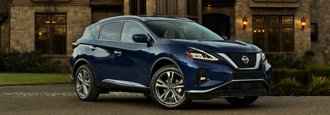 right side view of blue nissan murano
