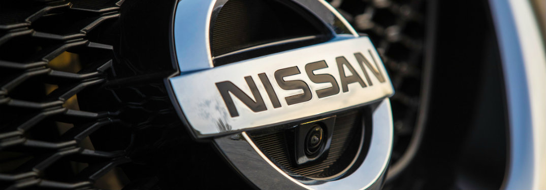 closeup of nissan logo on grille