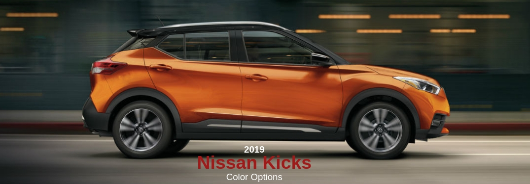 2019 Nissan Kicks Color Options, text below a passenger side exterior image of an orange 2019 Nissan Kicks