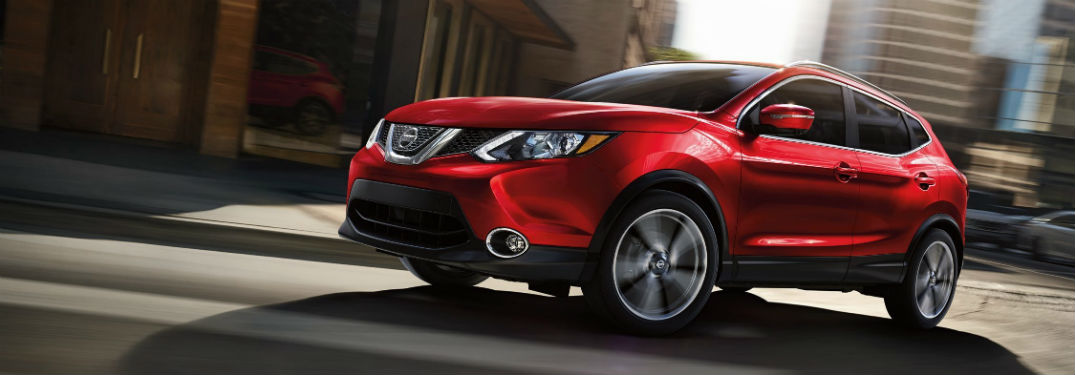 Driver side exterior view of a red 2019 Nissan Rogue Sport