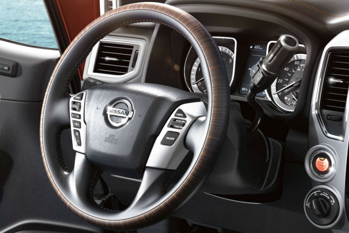 Steering wheel mounted controls and driver information cluster of the 2019 Nissan TITAN