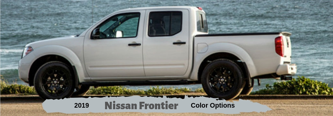 2019 Nissan Frontier Color Options, text below a driver side exterior image of a white 2019 Nissan Frontier