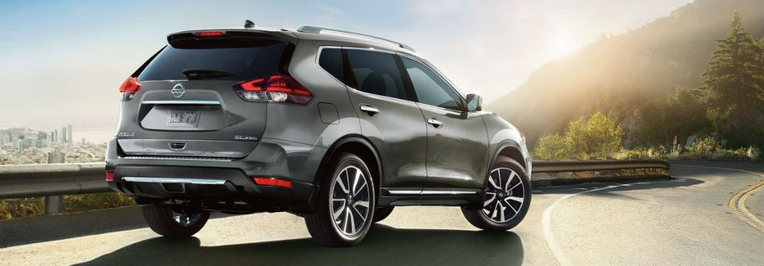 Rear passenger side exterior view of a gray 2019 Nissan Rogue