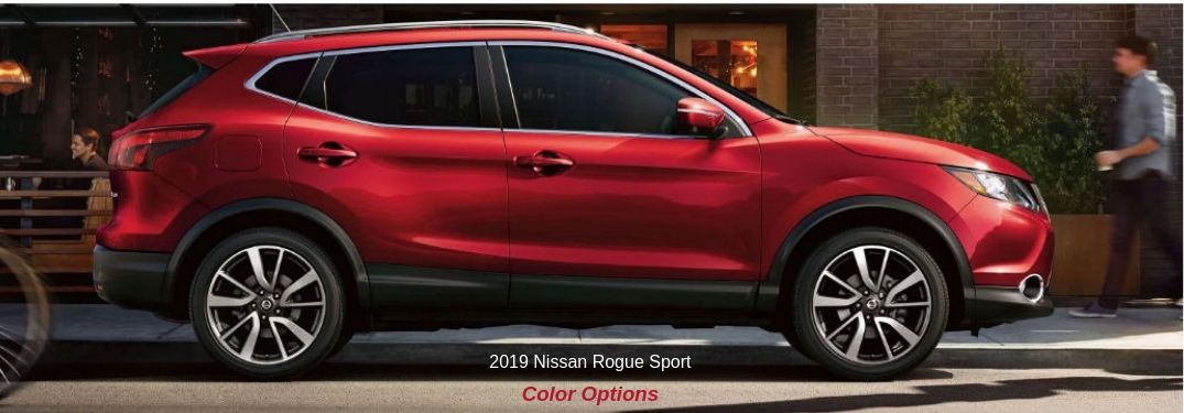 2019 Nissan Rogue Sport Color Options, text below a passenger side exterior image of a red 2019 Nissan Rogue Sport