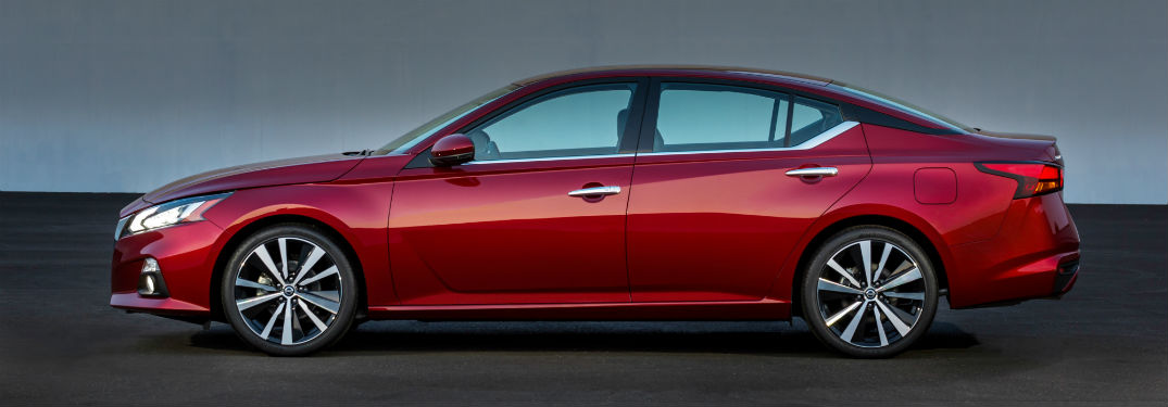 Driver side exterior view of a red 2019 Nissan Altima