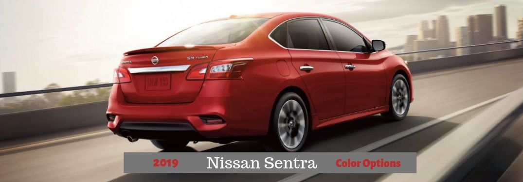 2019 Nissan Sentra Color Options, text below a rear passenger side exterior image of a red 2019 Nissan Sentra