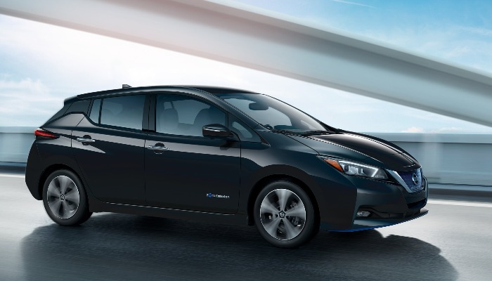 2019 Nissan Leaf driving down a highway