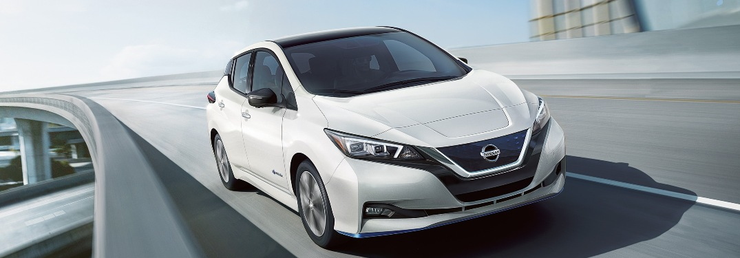 2019 Nissan Leaf driving down the highway
