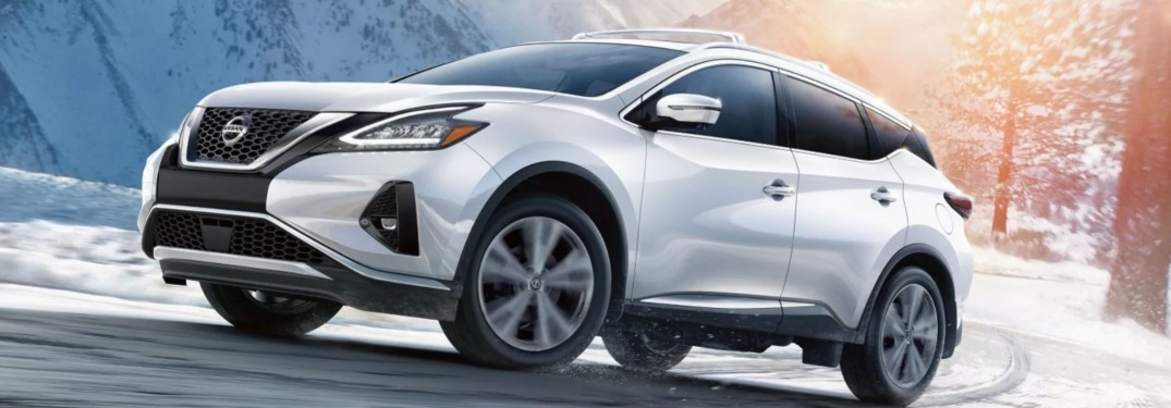 2019 Nissan Murano driving down a road in winter
