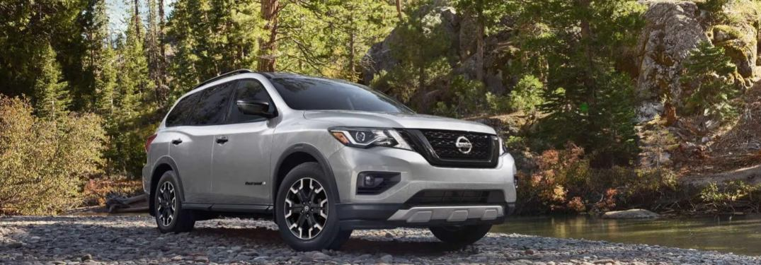 2019 Nissan Pathfinder parked on a forest trail