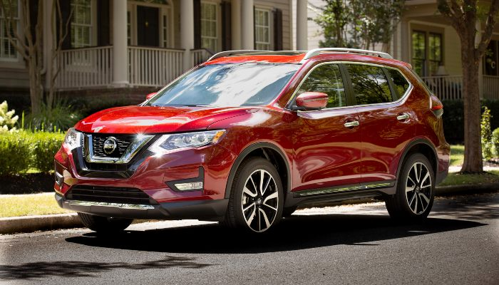 2019 Nissan Rogue driving down a city street
