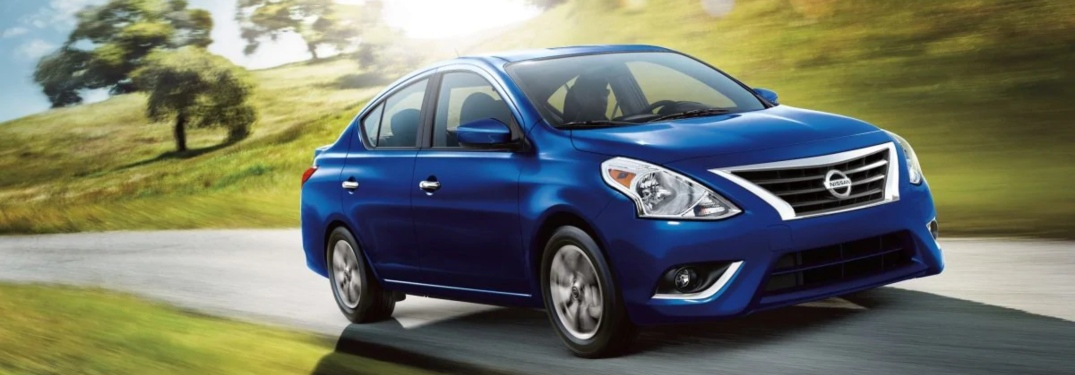 2019 Nissan Versa driving down a rural road