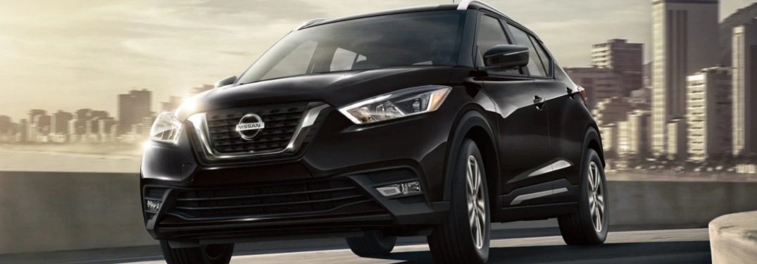 2019 Nissan Kicks driving down a highway road
