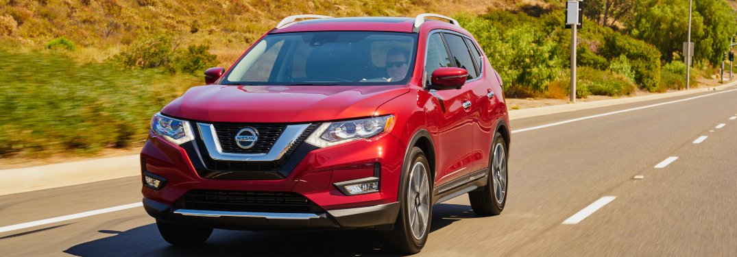 2020 Nissan Rogue driving down a rural road