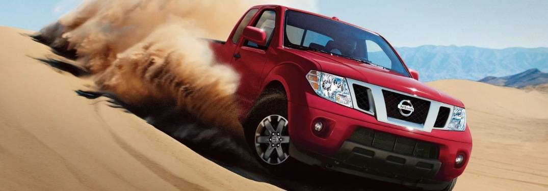 2019 Nissan Frontier driving down a sand dune