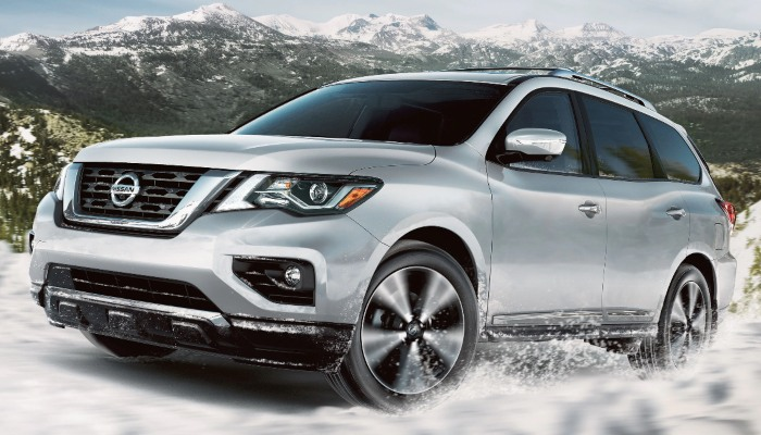 2020 Nissan Pathfinder driving on a snowy mountain