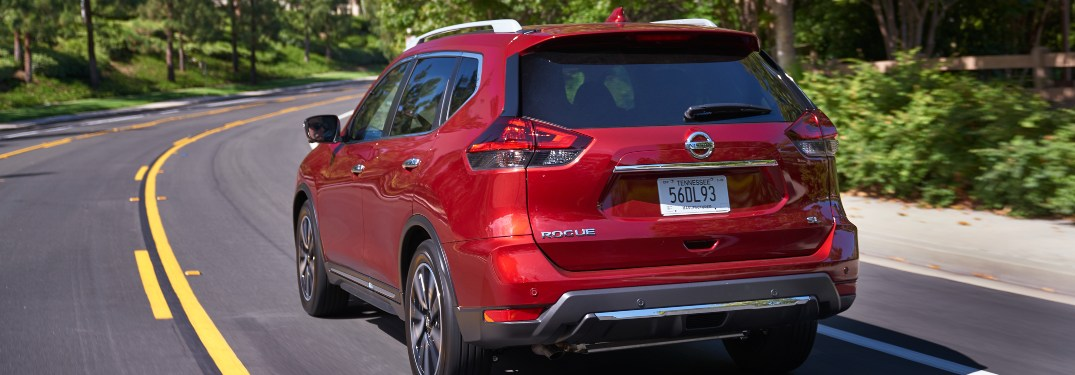 2020 Nissan Rogue driving down a winding road