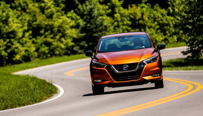 2020 Nissan Versa driving down a winding road