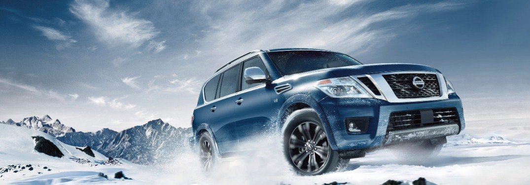2020 Nissan Armada driving down a snowy road