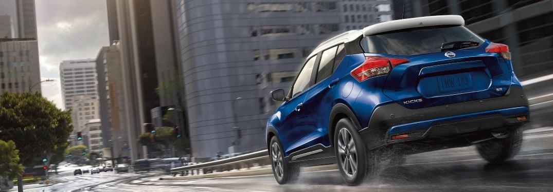 2020 Nissan Kicks driving down a city street