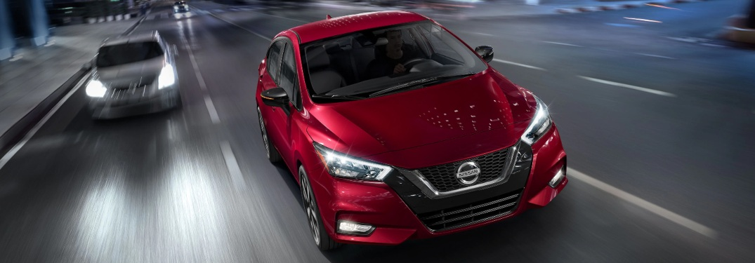 Two 2020 Nissan Versa models driving down a highway