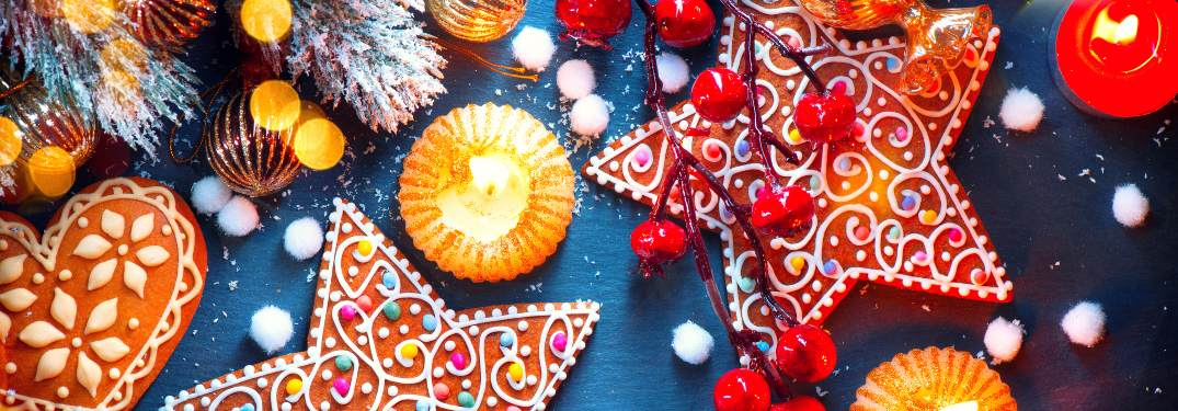 A wide spread of Christmas decorations and treats on a table