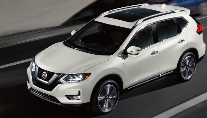 2020 Nissan Rogue driving down a highway