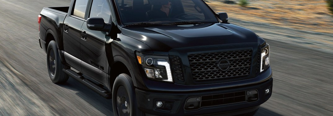 2020 Nissan TITAN driving down a highway road