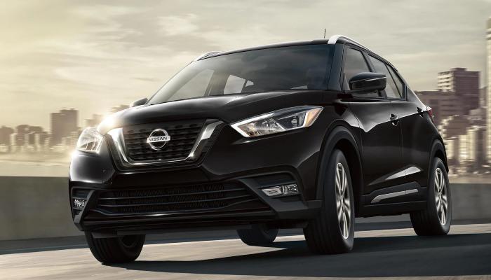 2020 Nissan Kicks driving down a highway