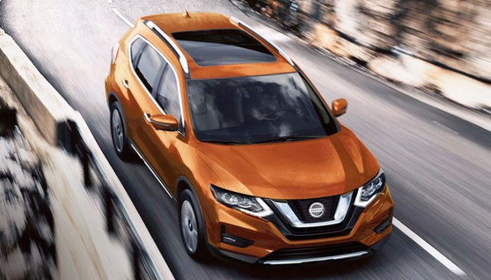 2020 Nissan Rogue driving down a mountainous road
