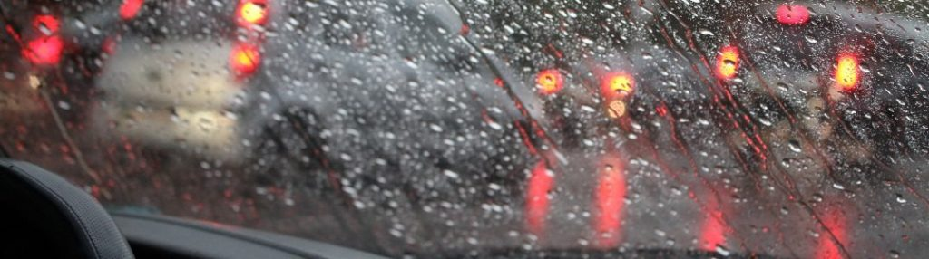Close-up of a wet windshield during a storm