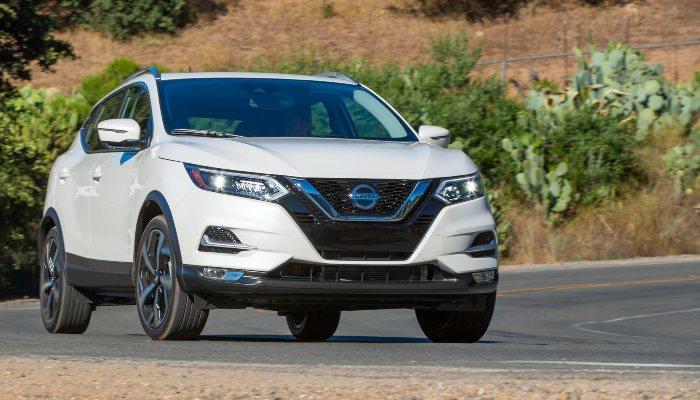 2020 Nissan Rogue Sport driving down a rural road