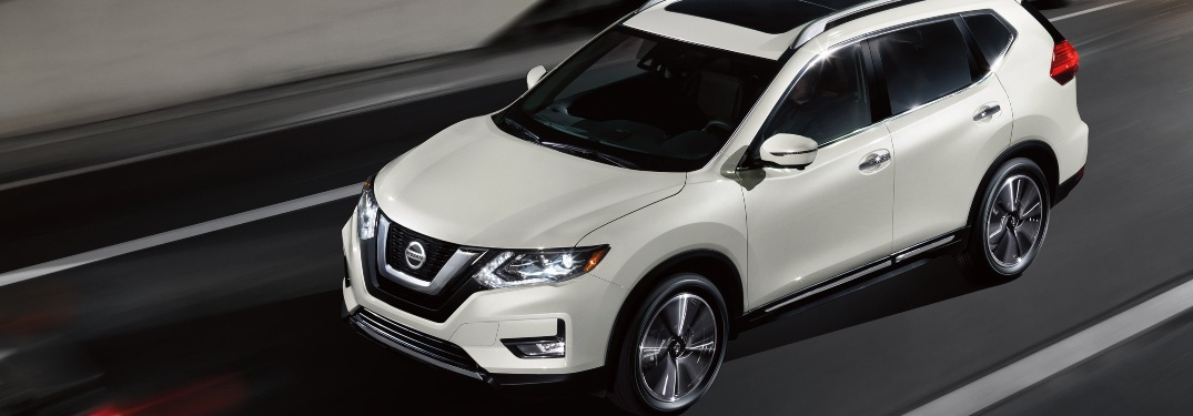 2020 Nissan Rogue driving down a highway road