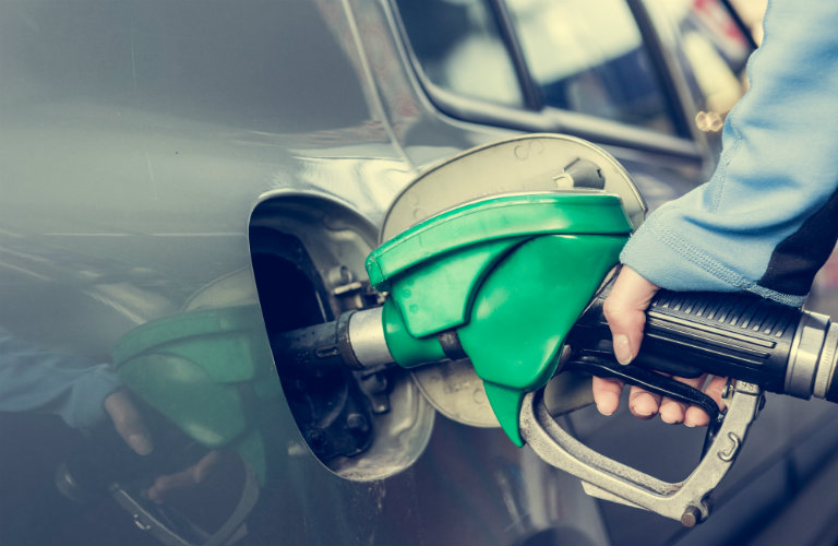A person refueling their vehicle