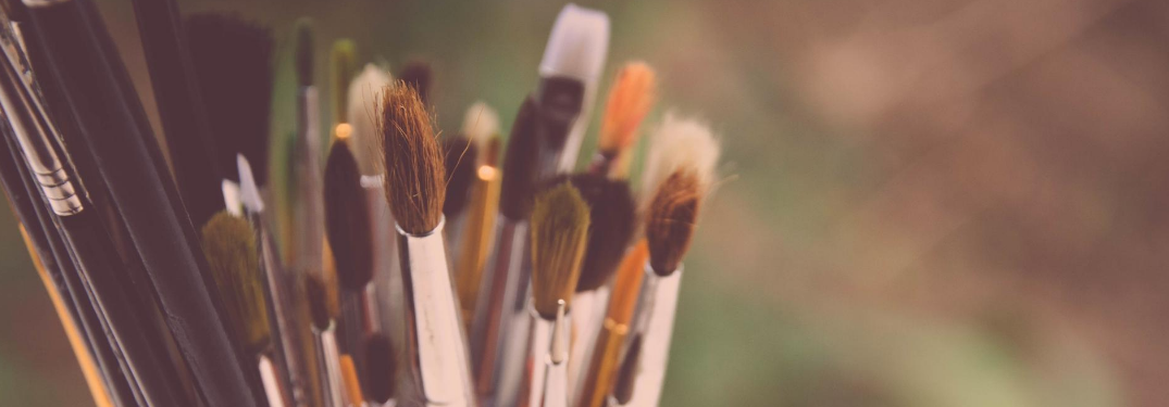 Close-up on paintbrushes in a container