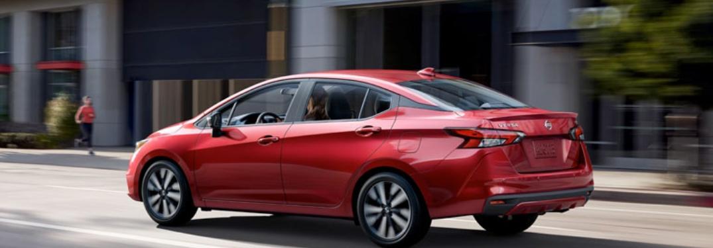 2020 Nissan Versa driving down a city street