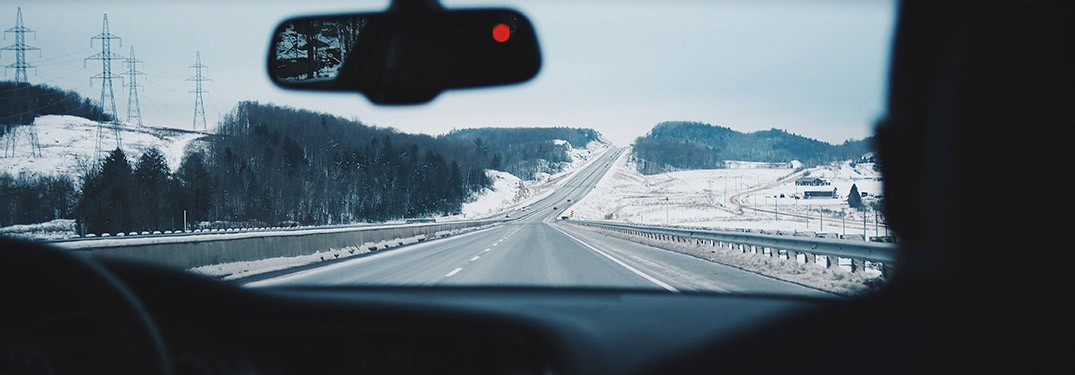 View of a winter road from a vehicle interior