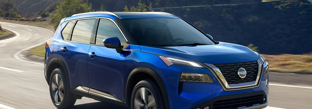 2021 Nissan Rogue driving down a highway road