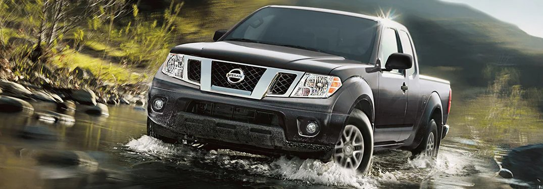 2021 Nissan Frontier driving through water