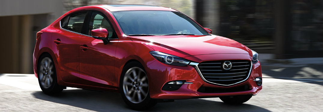 Red-2018-Mazda3-parked-on-driveway-in-front-of-house