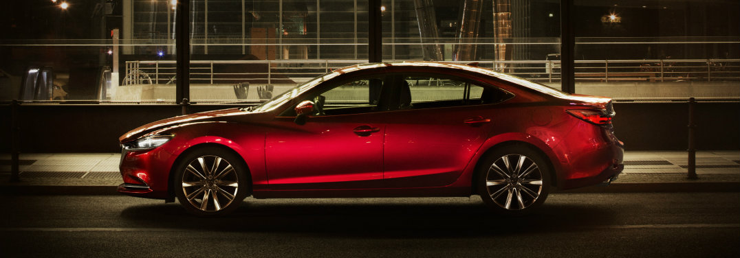 Red-2018-Mazda6-parked-in-front-of-building-with-big-windows