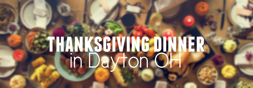 Text-saying-Thanksgiving-Dinner-in-Dayton-OH-with-blurred-background-of-Thanksgiving-dinner