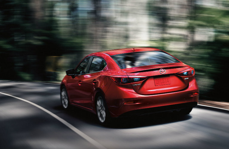 Red-2018-Mazda3-driving-on-curvy-road
