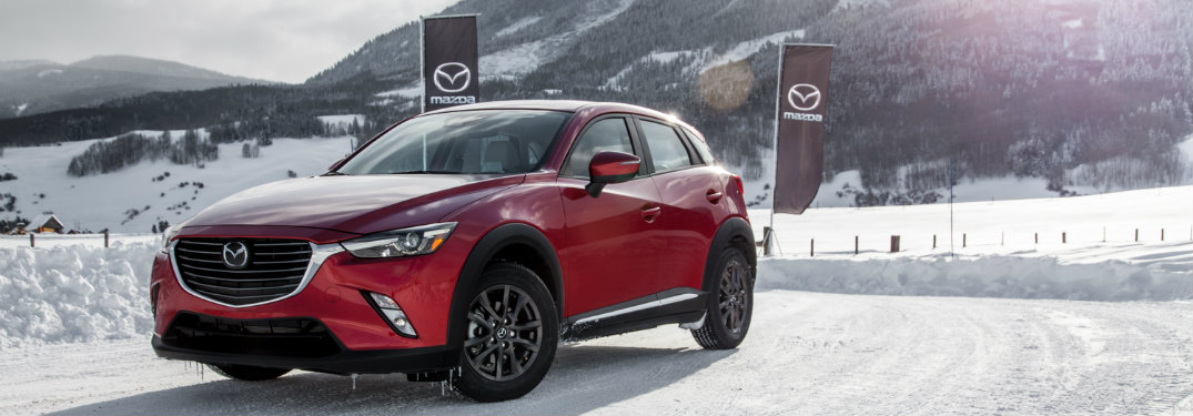 Red-2018-Mazda-CX-3-on-snow-covered-hill