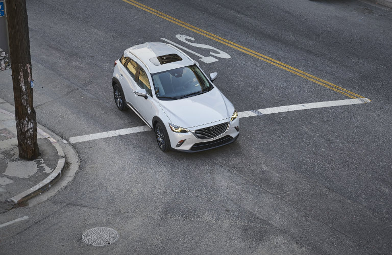 Birds-eye-view-of-2018-Mazda-CX-3-turning-corner-on-city-street