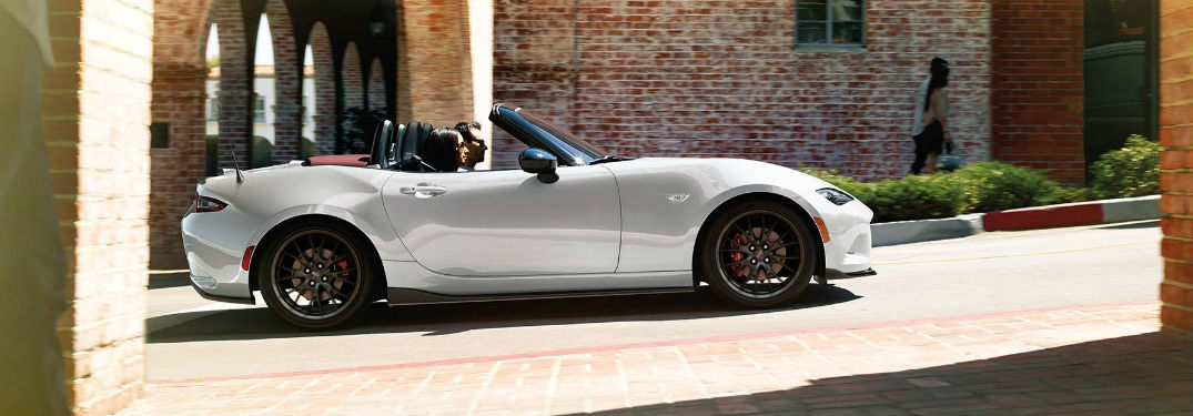 2018 Mazda MX-5 Miata Exterior passenger side profile against brick building