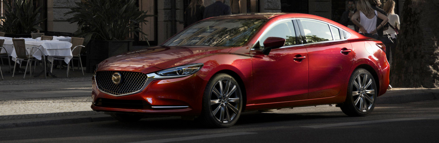 Red 2018 Mazda6 sitting on the road during the day,
