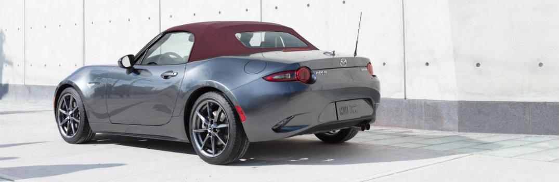 Gray Mazda Miata Sits In Showroom
